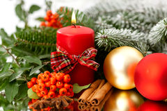 Candle, cinnamon and spruce Royalty Free Stock Photos