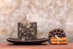 Candle and cinnamon sticks Royalty Free Stock Photography