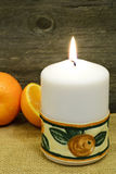 Candle and clementines... Royalty Free Stock Image