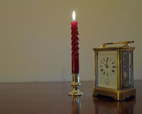 Candle & clock Stock Photo