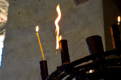Candle. A close-up of a candle in an old church Royalty Free Stock Images