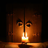 Candle with closed doors 2 Royalty Free Stock Photography