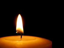 Candle closeup over black background. Royalty Free Stock Image