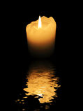 Candle closeup reflected by water surface Royalty Free Stock Image