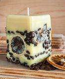 Candle with coffee beans Stock Photos