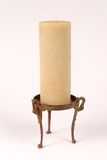 Candle on Copper Stand_8227-1S. Isolated Tall Candle on Copper Stand Stock Photography