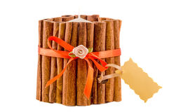 Candle covered in cinnamon sticks, close up, isolated white background Stock Images