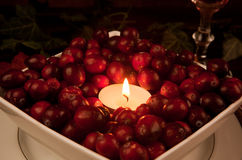 Candle in cranberries Stock Photo