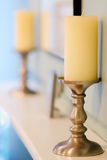 Unlit candle on a mantel Stock Image