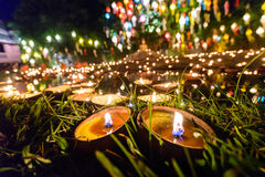candle cup in thai temple at night Royalty Free Stock Photos