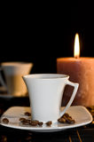 Candle and the cups of coffee. Stock Images