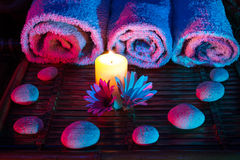 Candle daisys stones and towels Royalty Free Stock Photo