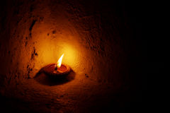 Candle in the dark. Candle in a cold dark night Stock Photography