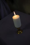 Candle on a dark background Royalty Free Stock Image