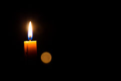 Candle on the dark Background Stock Photo