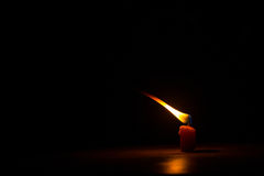 Candle in dark Stock Photo