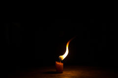Candle in dark Stock Photos