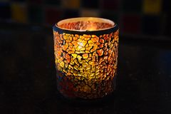 Candle in the Dark. Candle glowing in a holder in the Dark Stock Photography
