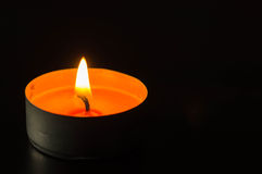 Candle in the dark Stock Images