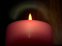 Candle in Darkness. Isolated lit candle royalty free stock image