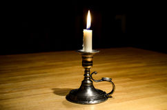 Candle in darkness Royalty Free Stock Images