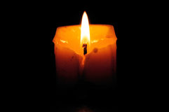Candle in the darkness. Royalty Free Stock Image