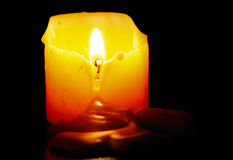 Candle in the darkness. Royalty Free Stock Photos