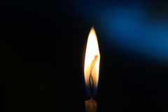 Candle in darkness Stock Photos