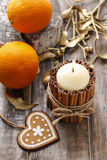 Candle decorated with cinnamon sticks, christmas decoration Stock Images