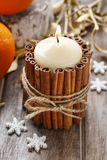 Candle decorated with cinnamon sticks, christmas decoration Royalty Free Stock Photo