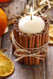 Candle decorated with cinnamon sticks, christmas decoration royalty free stock image