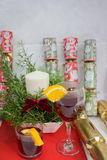 Candle display in a ceramic pot + fern for Christmas. Candle display in a ceramic pot plus a fern branches with a dark red bow for Christmas, also Glass of wine Stock Photography