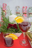 Candle display in a ceramic pot + fern for Christmas. Candle display in a ceramic pot plus a fern branches with a dark red bow for Christmas, also Glass of wine Royalty Free Stock Images