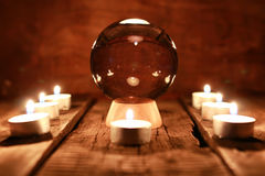 Candle divination tarot cards. Crystal ball for predicting the fate and supernatural action on the table from the old mahogany with candles and cards Stock Images