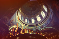 Candle and Dome of the Christian church inside Royalty Free Stock Photo