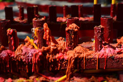 Candle drippings. Candles use in Religion lined up in a row a lot. The measured area For use in rituals Stock Photos