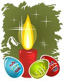 Candle and easter eggs. On a green background. Easter symbols Royalty Free Stock Image