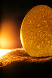 Candle and egg Royalty Free Stock Images