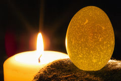 Candle and egg Stock Photo