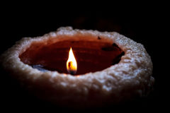 Candle Fading into Black Background Stock Images