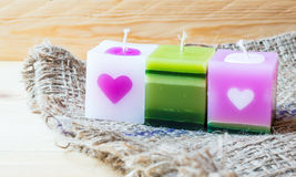 Candle. Fancy aroma candles on sack and wooden background Royalty Free Stock Photos