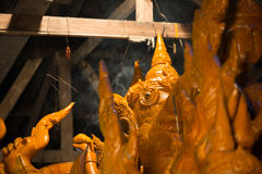 Candle festival 2017 culture in Thailand. Candle wax shaped as ancient animal on the candle float for candle festival competition in Ubon Ratchathani, Thailand Royalty Free Stock Images