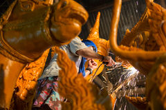 Candle festival 2017 in Thailand. Craftsman fix the candle on the candle float for candle festival in Ubon Ratchathani, Thailand on June 08, 2017 Stock Images