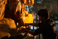 Candle festival 2017 in Thailand. Craftsman fix the candle on the candle float for candle festival in Ubon Ratchathani, Thailand on June 08, 2017 Royalty Free Stock Images