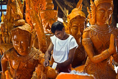 Candle Festival. Ubon Ratchathani, Thailand - July 7, 2013: A craftsman of Wat Pha Sukaram temple was crafting candle among Thai literary figures stock photo