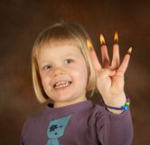 Candle fingers Stock Images