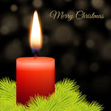 Candle and fir. With abstract lights background Stock Images