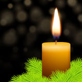 Candle and fir. With abstract lights background Royalty Free Stock Photos