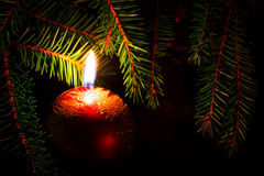 Candle and fir branches Stock Photos