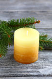 Candle and fir branches on the boards Royalty Free Stock Image